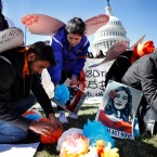 "Supporters of the Deferred Action for Childhood Arrivals (DACA) program place paper flowers on the ground in a pattern that spells out the word ""unafraid"" as they rally in support of DACA recipients, Monday, March 5, 2018, on Capitol Hill in Washington."