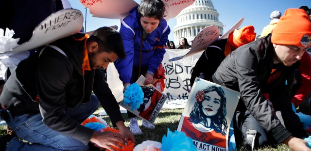 """Supporters of the Deferred Action for Childhood Arrivals (DACA) program place paper flowers on the ground in a pattern that spells out the word """"unafraid"""" as they rally in support of DACA recipients, Monday, March 5, 2018, on Capitol Hill in Washington."""