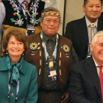U.S. Secretary of State Rex Tillerson, seated right, and U.S. Sen. Lisa Murkowski, seated left, pose with Nulato Chief Mickey Stickman at an Arctic Council event in Fairbanks, Alaska. High-level officials from the world's eight Arctic nations, including Tillerson, will meet in Alaska amid concerns about the future of the sensitive region after President Trump called for more oil drilling and development.