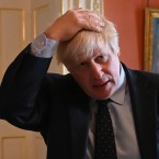 British Prime Minister Boris Johnson, seen hosting health service workers Tuesday at No. 10 Downing St. in London. The same day in the House of Commons, Johnson was dealt a political blow when the defection of a fellow Conservative left him without a working majority in Parliament.