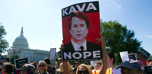 Demonstrators protest against Supreme Court nominee Brett Kavanaugh, as they march to the U.S. Supreme Court, on Thursday, Oct. 4, 2018, in Washington.