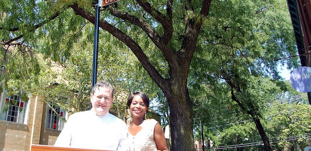 Charlie and Rochelle Trotter hold newly unveiled Honorary Charlie Trotter Way street sign