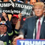 Coal miners wave signs as Republican presidential candidate Donald Trump