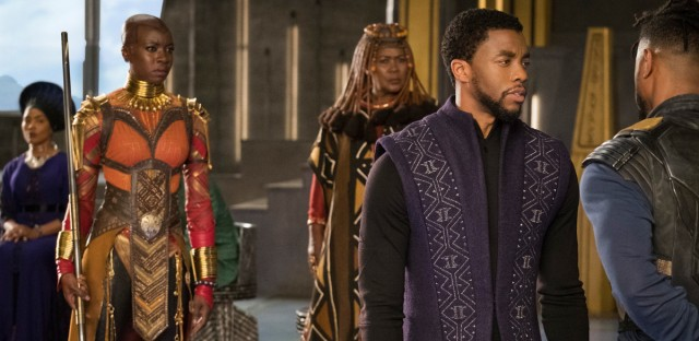 A scene from Black Panther. The titular hero, played by Chadwick Boseman, is on the right.