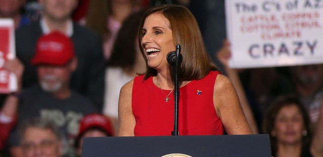 Republican Martha McSally speaks at a rally for President Trump on Oct. 19 in Mesa, Ariz. McSally is in a tight Senate race with Democratic Rep. Kyrsten Sinema.