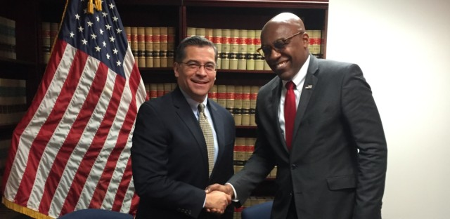 Illinois Attorney General Kwame Raoul (right) meets with California Attorney General Xavier Becerra on March 14, 2019, in Chicago. Illinois and California are among 20 states suing the federal government to stop President Donald Trump's declaration of a national emergency at the U.S.-Mexico border.