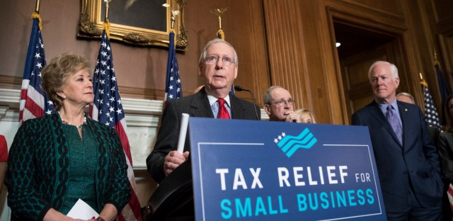 Senate Majority Leader Mitch McConnell, R-Ky., center, joined by, from left, Linda McMahon, administrator of the U.S. Small Business Administration, Sen. Jim Risch, R-Idaho, chairman of the Senate Small Business Committee, and Majority Whip John Cornyn, R-Texas, hold a news conference to talk about the Republican tax plan and how they say it will help small business, on Capitol Hill in Washington, Tuesday, Nov. 28, 2017.