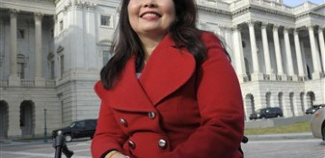 Rep.-elect Tammy Duckworth, D-Ill. is seen on Capitol Hill in Washington, Thursday, Jan. 3, 2013, as she poses with other female House members prior to the official opening of the 113th Congress.