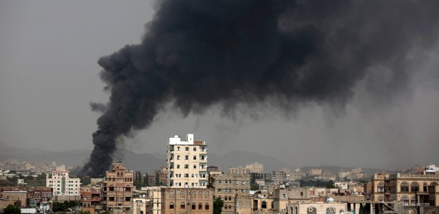 Smoke rises after Saudi-led airstrikes hit a food factory in Sanaa, Yemen on August 9, 2016. In the air campaign by Saudi Arabia and its allies against Yemen's Shiite rebels, rights experts say there has been a pattern by the Saudi-led coalition in depending on faulty intelligence, failing to distinguish between civilian and military targets and disregarding the likelihood of civilian casualties. Experts say some of the strikes likely amount to war crimes. (AP Photo/Hani Mohammed)