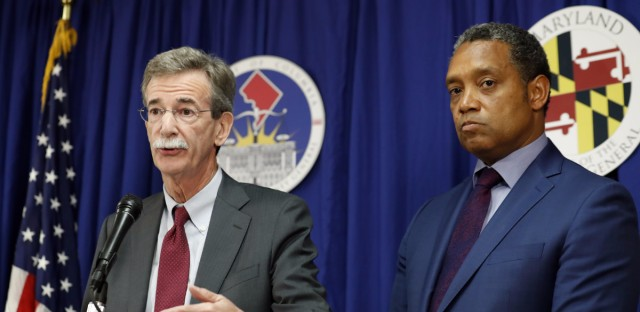 Maryland Attorney General Brian Frosh (left) and District of Columbia Attorney General Karl Racine announce a lawsuit against President Trump over conflicts of interest with his businesses on Monday in Washington.