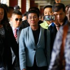 Maria Ressa, center, the award-winning head of a Philippine online news site Rappler, is escorted into the court room to post bail at a Regional Trial Court following an overnight arrest by National Bureau of Investigation agents on a libel case Thursday, Feb. 14, 2019 in Manila, Philippines. Ressa was freed on bail Thursday after her arrest in a libel case.