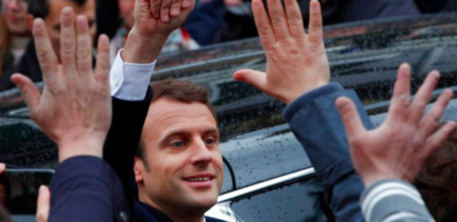 French independent centrist presidential candidate Emmanuel Macron waves as he leaves the polling station after casting his ballot in the presidential runoff election in Le Touquet, France, Sunday, May 7, 2017. Voters across France are choosing a new president in an unusually tense and important election that could decide Europe's future, making a stark choice between pro-business progressive candidate Emmanuel Macron and far-right populist Marine Le Pen.