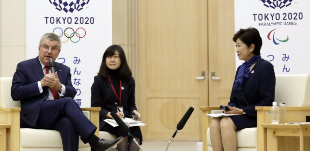 International Olympic Committee President Thomas Bach says new changes will boost female participation in the Olympics and attract young, urban viewers. He's seen here last fall, with Tokyo Governor Yuriko Koike, right, and a translator.