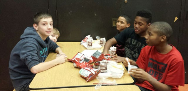 Students during lunch period at Ravenswood Elementary chow down on Doritos, nacho cheese and sunflower butter. The new nut-free policy means peanut butter isn't allowed.
