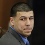 Former New England Patriots tight end Aaron Hernandez looks at the jury after his double murder acquittal last week. Hernandez, who was already serving a life sentence witout parole for murder, hanged himself and was pronounced dead at a Massachusetts hospital early Wednesday, according to officials.