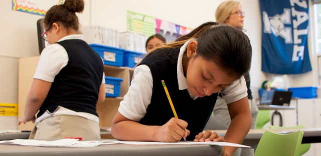 A student works on a language arts assignment at the Christopher House James & Jean Stewart Campus in Chicago's Belmont Cragin neighborhood. The school was one of few to see growth in PARCC schools this year.