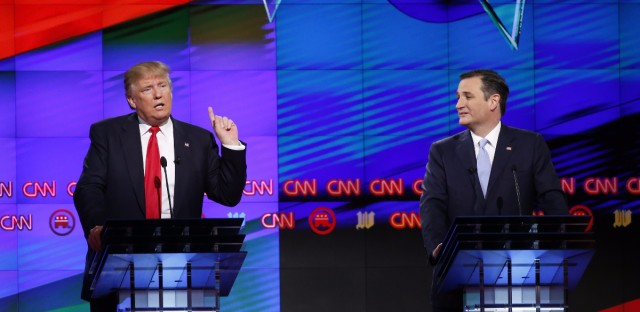 Republican presidential candidate, businessman Donald Trump speaks, as Republican presidential candidate, Sen. Ted Cruz, R-Texas, listens, during the Republican presidential debate in Florida.