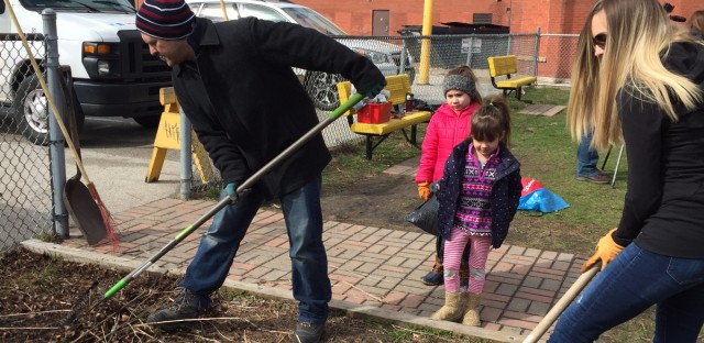 Parents at Sheridan Math and Science Academy help clean the school's garden on a Chicago Public Schools furlough day.