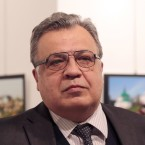 Russia's ambassador to Turkey, Andrei Karlov, speaks at a gallery in Ankara, Turkey, on Monday. Shortly afterward, a gunman opened fire.