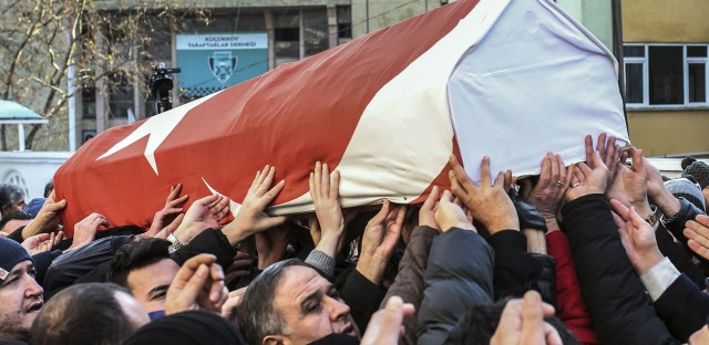 Family members and friends carry a coffin containing the remains of Ayhan Akin, one of the nightclub shooting victims in Sunday's attack in Istanbul, Turkey.