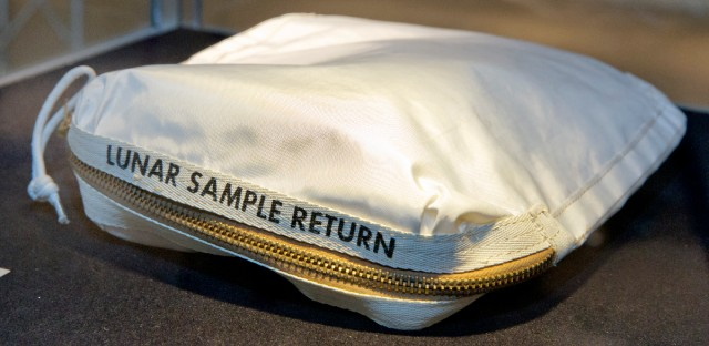 The Apollo 11 Contingency Lunar Sample Return Bag used by astronaut Neil Armstrong — to be offered at auction — is displayed at Sotheby's in New York on July 13, 2017. The bag containing traces of moon dust is heading to auction, surrounded by some fallout from a galactic court battle. The pre-sale estimate is $2 million to $4 million. (AP Photo/Richard Drew, File)