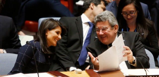 United States Ambassador to the United Nations Nikki Haley speaks to Uruguay's U.N. Ambassador Elbio Rosselli before a vote to adopt a new sanctions resolution against North Korea during a meeting of the U.N. Security Council at U.N. headquarters, Monday, Sept. 11, 2017.