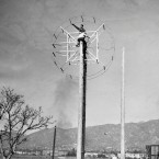 This new shortwave radio antenna, recently developed, is now installed at Glendale Airport to concentrate radio waves for the aid of airplane pilots and ground attendants with whom they communicate while traveling, shown Dec. 21, 1936.