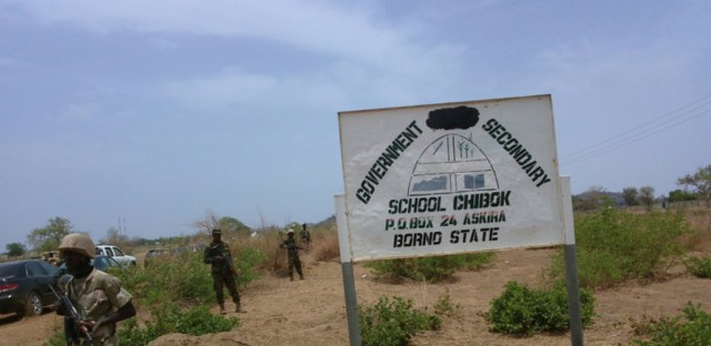 Soldiers stand guard in front of the government secondary school Chibok in 2014 in Chibok. Nigeria.