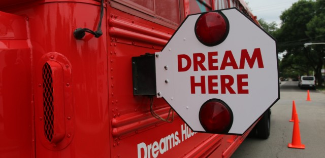 The Dream Village Tour bus parked outside of Little Black Pearl at 47th Street and Greenwood Avenue in Chicago's Kenwood neighborhood.
