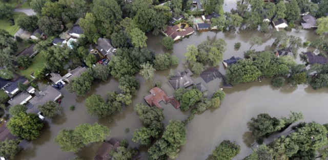 With clear daylight breaking over parts of eastern Texas on Tuesday, scenes of devastating flooding are emerging. These homes are in Spring, Texas.