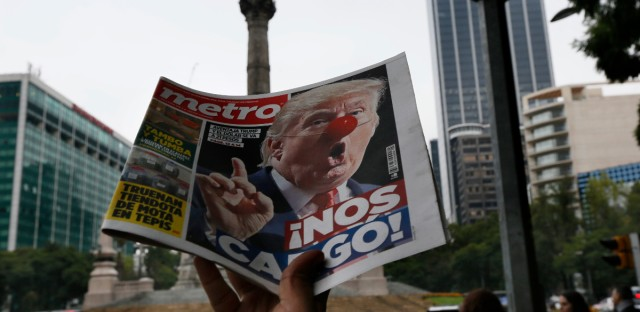 "A street vendor hawks a newspaper emblazoned with an image of Donald Trump with a clown's nose, and a headline that reads in Spanish: ""We're screwed!,"" in front of the Angel of Independence monument, in Mexico City, Wednesday, Nov. 9, 2016. President-elect Trump's triumph over Hillary Clinton ends eight years of Democratic dominance of the White House. Trump has pledged to usher in sweeping changes to U.S. foreign policy, including building a wall along the U.S.-Mexico border."