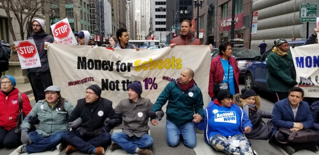 Protesters block traffic on LaSalle Street as the Chicago City Council considers two controversial real estate projects.