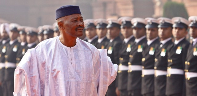 In this Jan. 11, 2012 file photo, Malian President Amadou Toumani Toure inspects an honor guard during a ceremonial reception at the Presidential Palace in New Delhi, India. From one of the hiding places where he has been holed up since a March 21 coup, Mali's president penned a resignation letter Sunday, April 8, 2012, and in the presence of reporters on handed it to an emissary to deliver to the country's new leaders.