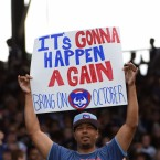 A fan of the Chicago Cubs holds a poster during the seventh inning of the game against the Cincinnati Reds on Sunday, October 1, 2017. (AP Photo/David Banks)