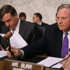 Senate Intelligence Committee Chairman Richard Burr, R-N.C., (right) gavels into order a hearing with the heads of the United States intelligence agencies with and ranking member Sen. Mark Warner, D-Va., on Capitol Hill on May 11. They are holding another hearing on intelligence on Wednesday.