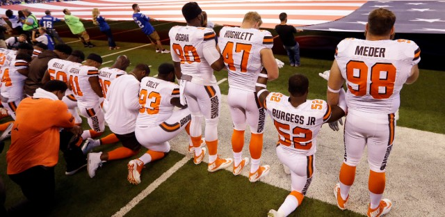Members of the Cleveland Browns take a knee during the national anthem before a game against the Indianapolis Colts in Indianapolis on Sunday, Sept. 24, 2017. (AP Photo/Michael Conroy)