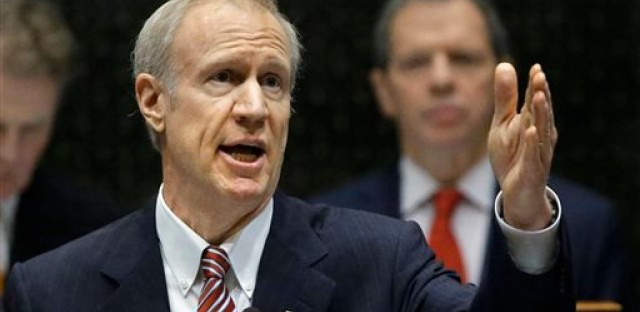 In this Feb. 4, 2015 file photo, Illinois Gov. Bruce Rauner delivers his first State of the State address at the Capitol in Springfield. Rauner takes pride in not being like any of Illinois' previous governors. After the most unusual first year of any new governor in the country, Rauner is starting 2016 with signs that the strangest may be yet to come.
