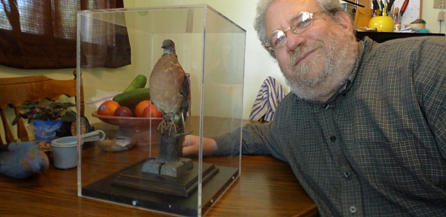 """Author Joel Greenberg poses with his stuffed passenger pigeon, Heinrich. Greenberg is author of, """"A Feathered River Across the Sky, The passenger pigeon's Flight to Extinction."""""""