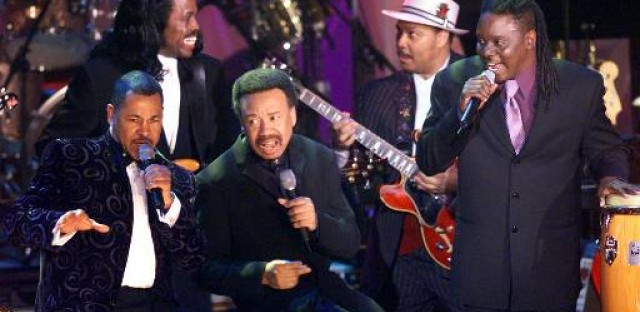 Members of Earth, Wind & Fire surround the band's leader and founder Maurice White, center. The band, which rose to prominence in the Seventies, solidified the growth of black album music as it brought together the earlier sounds of jazz, blues, R&B, pop, gospel, funk and deep soul.