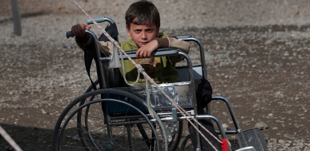 Muhammed El Hadji, a disabled Syrian refugee boy, sits on a wheelchair at a camp for Syrian refugees in Islahiye, Gaziantep province, southeastern Turkey,Wednesday, March 16, 2016.