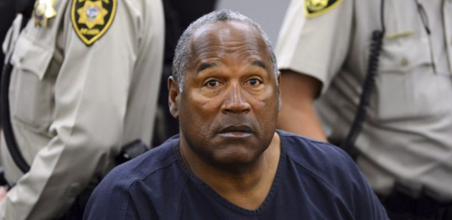 O.J. Simpson during a break in a court hearing in Las Vegas in 2013. Simpson is up for parole after nearly nine years in prison on charges stemming from a bid to retrieve sports memorabilia. (Ethan Miller/AP)