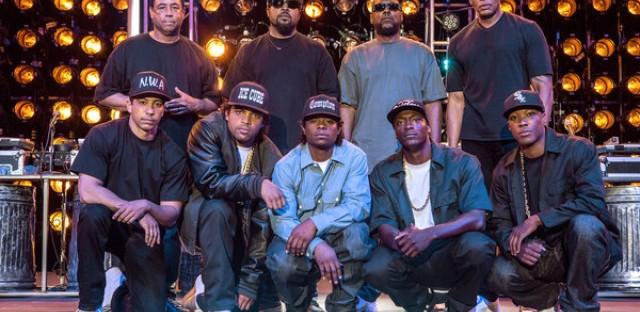 N.W.A real and fictional: Top row: DJ Yella, Ice Cube, MC Ren, Dr. Dre; bottom: Neil Brown Jr., O'Shea Jackson Jr., Jason Mitchell, Aldis Hodge and Corey Hawkins.
