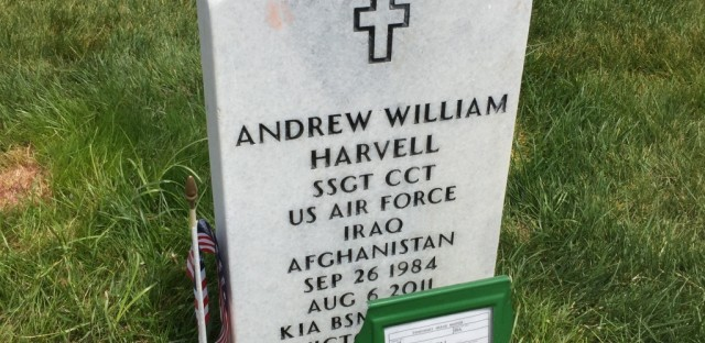 A headstone in Section 89A marks the grave of Staff Sergeant Andrew Harvell. A temporary marker notes that his brother, Sean Harvell, is buried there as well.