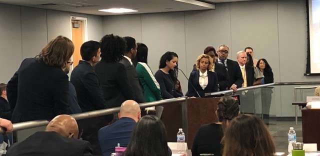 Chicago principals line up to praise Chicago Schools CEO Janice Jackson at Wednesday's Chicago Board of Education meeting. With Mayor Rahm Emanuel leaving office, she faces an uncertain future.