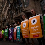 Pro independence supporters hold banners calling for voting Yes on a planned independence referendum in the Catalonia region, during a demonstration in Barcelona, Spain, Sunday, Sept. 17, 2017.
