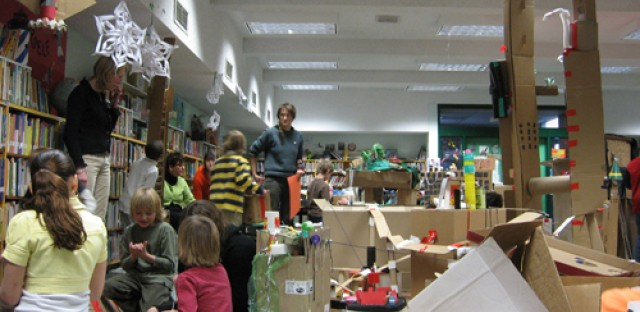 New Your City, Ian Cozzens' collaboratively built cardboard city, in the Fox Point branch of the Providence Public Library in 2007. Cozzens, center, helped kids channel their inner urban planner.