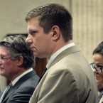 Chicago police officer Jason Van Dyke, center, attends a hearing at the Leighton Criminal Court Building, in Chicago.