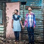 Aniket Sathe, 15, is in a program that's trying to persuade India's boys to treat girls as their equals. Here he's pictured with his younger sister, Aarati, 12, waiting for the rain to stop before walking her to school.