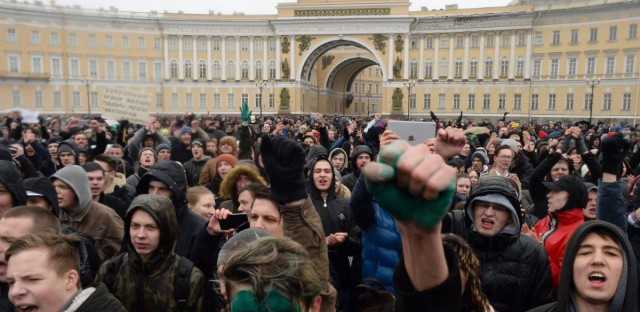 Protesters participate in an anti-corruption rally in Saint Petersburg on March 26. Thousands of Russians demonstrated across the country to protest corruption.