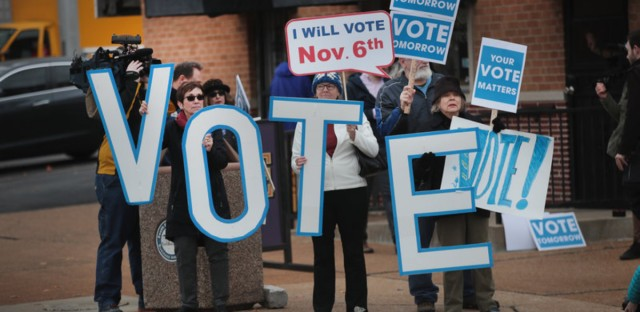"""Supporters of Senator Claire McCaskill, D-Mo., with signs that say """"vote"""" wait for the senator to arrive for a campaign stop Monday in St. Louis, Mo. Scott Olson/Getty Images"""
